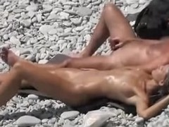 Two couples nude on the beach