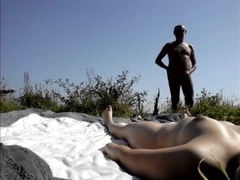 Me spreads my legs on nude beach for strangers