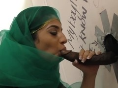 Nadia Ali having fun with black cock in a gloryhole