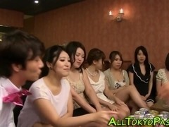 Asian babes fuck at orgy