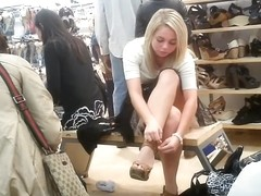 Blonde girl upskirtvoyeured in the shoe store.