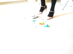 crushing little cars in black tights and heels