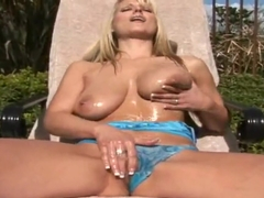 Lovely blonde Simone Ray doing some hot masturbation on the pool